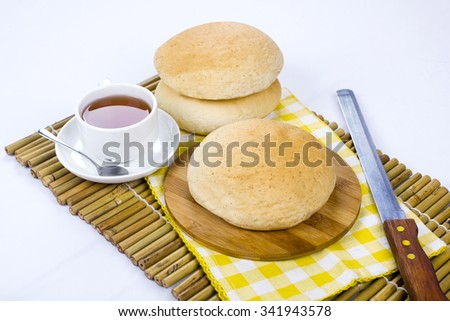 arabic bread and hot tea on isolated background - stock photo