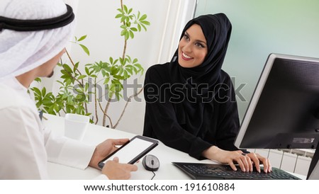 Arabic Business Couple Working In Office Using Tablet And Computer - stock photo