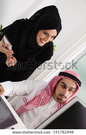 Arabic Business Couple Working In Office Using Tablet And Computer