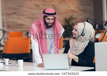 Arabic business couple working together on project at modern startup office