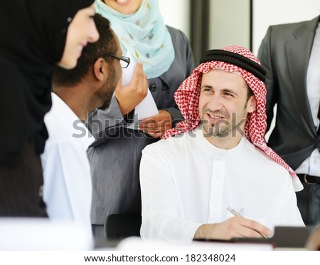 Arabic business people working in office - stock photo