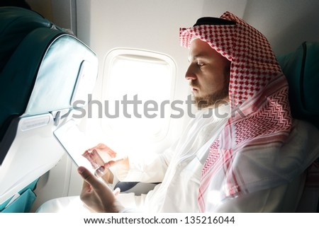 Arabic businessman working on tablet computer - stock photo