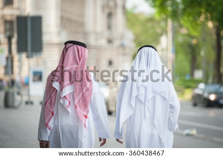 Arabic businessmen walking on the street