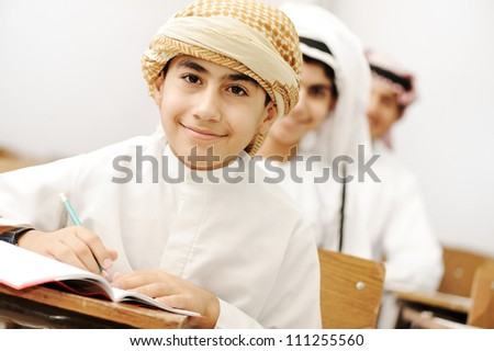 Arabic children in school classroom - stock photo