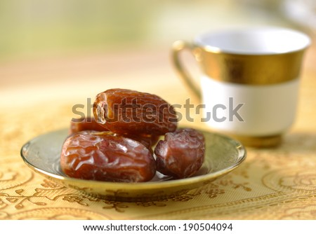 Arabic dates and tea - stock photo