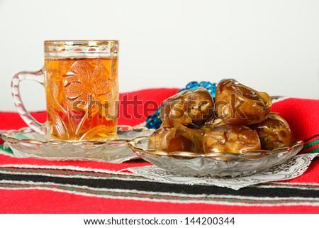 Arabic dates and tea. Ramadan tradition. - stock photo