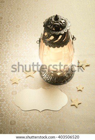 Arabic decorative lantern and empty tag. Eid or Ramadan festival background. - stock photo