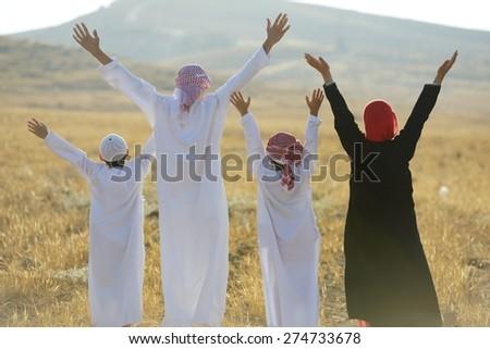 Arabic family in nature - stock photo