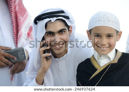 Arabic Gulf people talking on cell phone - stock photo