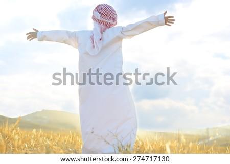Arabic happy child in nature - stock photo