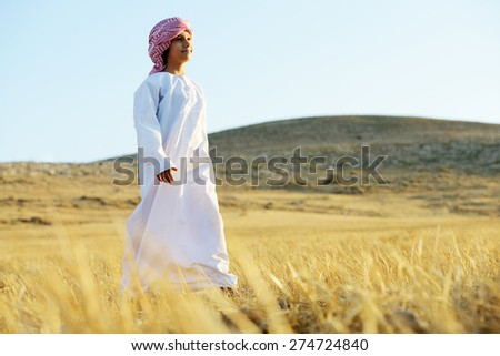 Arabic happy child in nature - stock photo
