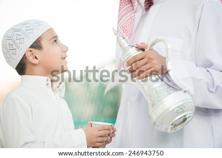Arabic hospitality symbol as pouring dallah or coffee pot - stock photo