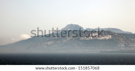 Arabic inscription in a mountain near the Tangier Med port, Morocco - stock photo
