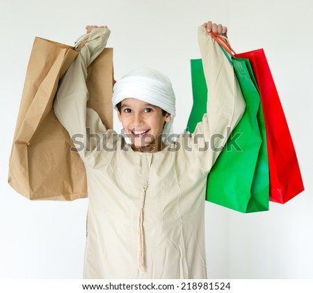 Arabic kid with shopping bags - stock photo