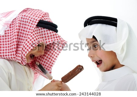 Arabic kids eating ice-cream - stock photo