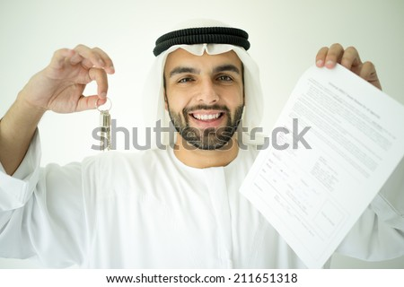 Arabic man making successful deal - stock photo