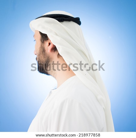 Arabic man with traditional clothes and headscarf wheel - stock photo