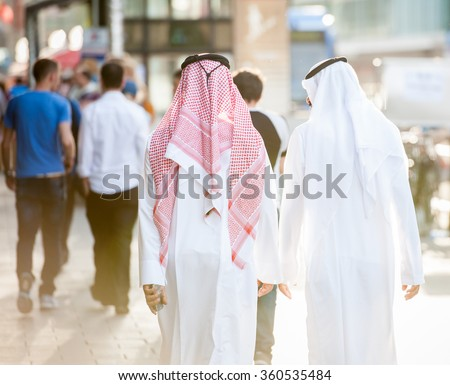 Arabic men on the street - stock photo