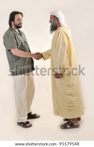 Arabic Muslim businessman person shaking hands - stock photo