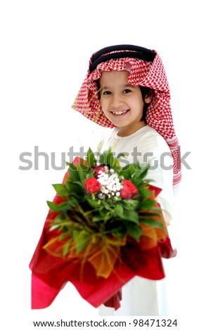 Arabic Muslim kid with bouquet of flowers - stock photo