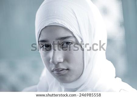 Arabic Muslim Middle Eastern girl wearing white - stock photo