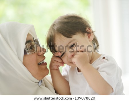 Arabic Muslim mother with baby - stock photo