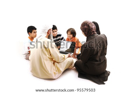 Arabic Muslim teacher with children students