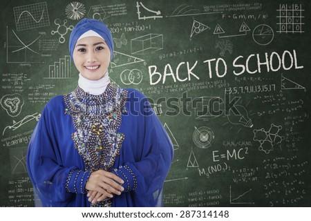 Arabic muslim teenage student inside the high school classroom - stock photo
