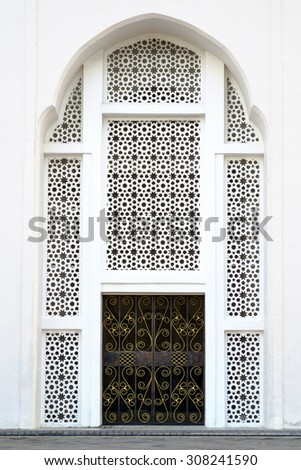 Arabic ornament on a wall - stock photo