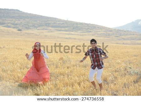 Arabic people enjoying on beautiful meadow - stock photo