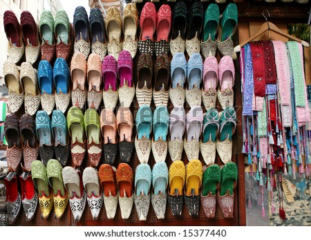 Arabic slippers in a shop window. - stock photo