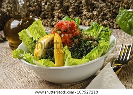 Arabic style salad tabbouleh. - stock photo