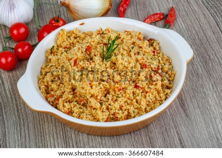 Arabic traditional cuisine - Couscous with tomato and green onion - stock photo