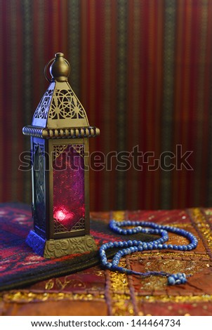 Arabic traditional lamp and rosary - stock photo