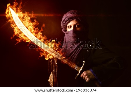 Arabic Woman warrior with sword on fire against a dark background - stock photo