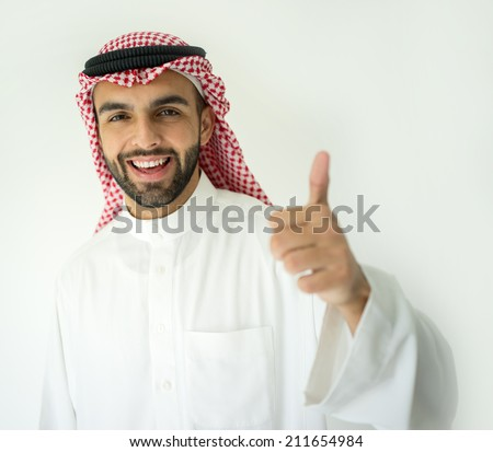 Arabic young businessman with thumb up - stock photo