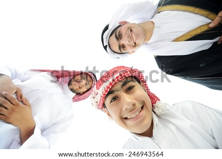 Arabic young guys in circle smiling - stock photo