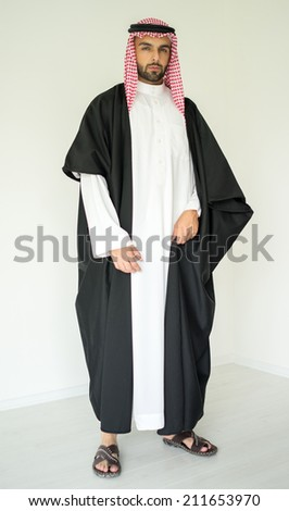 Arabic young sheikh posing - stock photo