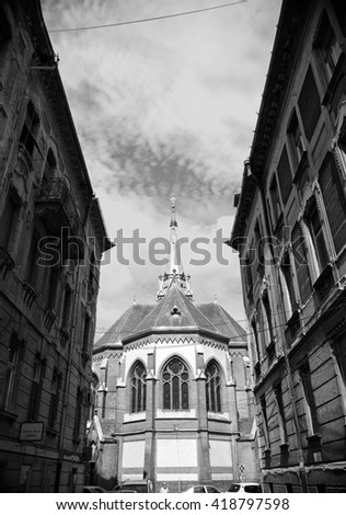 Arad street and The Evangelical Church  built in neo-gothic style, Romania - stock photo