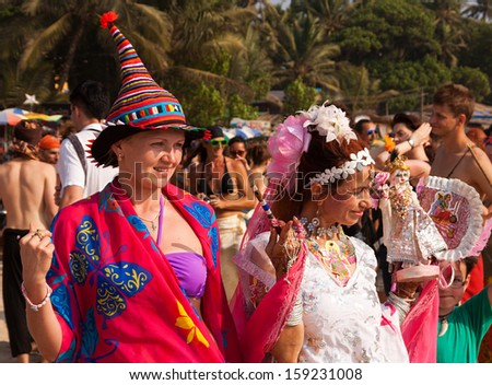 ARAMBOL, GOA, INDIA - FEB. 5: Two unidentified women in carnival costumes at the annual festival of Freaks on FEB. 5, 2013 in Arambol beach, Goa, India