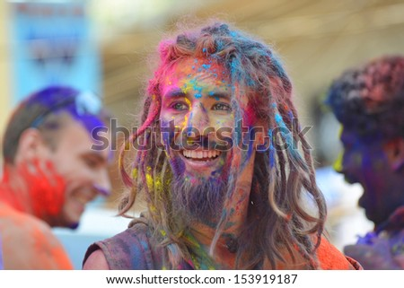 ARAMBOL, GOA - MARCH 27: Unidentified man celebrates Holi festival in Arambol Main Street, GOA, India on March 27, 2013. It's a religious spring holiday and also known as Festival of Colours.