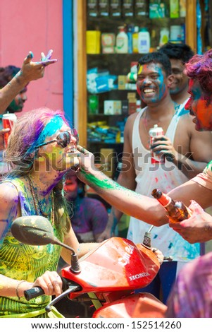 ARAMBOL, GOA - MARCH 27: Unidentified people celebrate Holi festival in Arambol Main Street, GOA, India on March 27, 2013. It's a religious spring holiday and also known as Festival of Colours. - stock photo