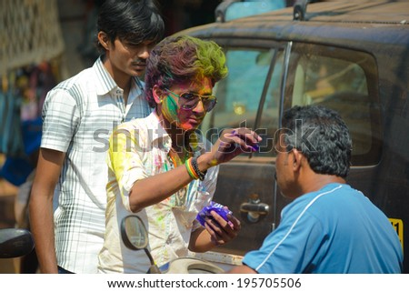 ARAMBOL, GOA - MARCH 17: Unidentified people celebrate Holi festival in Arambol Main Street, GOA, India on March 17, 2014. It's a religious spring holiday and also known as Festival of Colours.