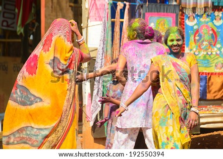 ARAMBOL, GOA - MARCH 17: Unidentified people celebrates Holi festival in Arambol Main Street, GOA, India on March 17, 2014. It's a religious spring holiday and also known as Festival of Colours.