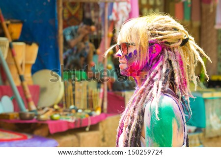 ARAMBOL, GOA - MARCH 27: Young woman celebrates Holi festival in Arambol Main Street, GOA, India on March 27, 2013. It's a religious spring holiday and also known as Festival of Colours.