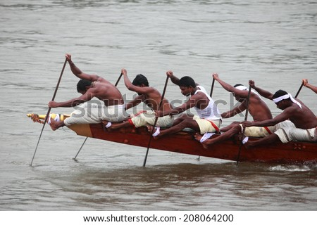 ARANMULA, INDIA - SEPT 14:A team of oarsmen wearing traditional dress participate in the most popular Aranmula boat race held on September 14, 2011 in Aranmula, Kerala, India. - stock photo