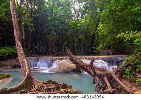 Arawan waterfall in tropical forest Thailand,leaf moving low speed shutter blur