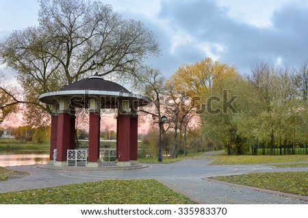 Arbor in the morning park. Autumn colors - stock photo