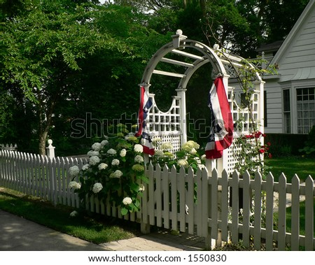 Arbor with red, white and blue bunting - stock photo