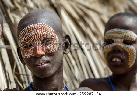ARBORE, ETHIOPIA, 13 AUGUST:unidentified boy from Arbore tribe in Arbore, Ethiopia, on 13 august 2014. Body painting is done by the Arbore using natural colors made from soil and stone. - stock photo